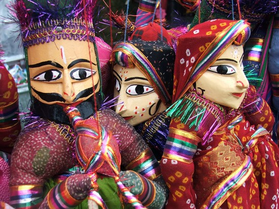 close up of colourful indian puppets with painted faces and bright clothes
