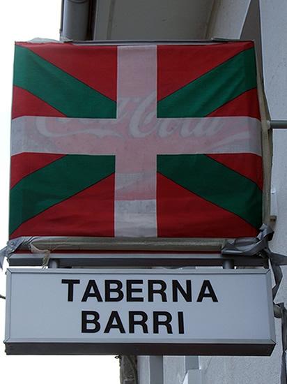 Basque flag covering a coca-cola sign (ikurriña cubriendo un cartel de coca-cola)