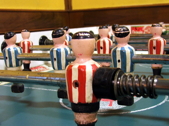 close up of players in a table football game