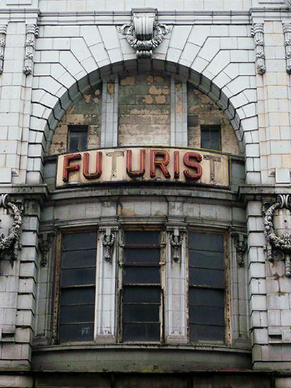 neclasical building facade with a broken sign reading 'Futurist'