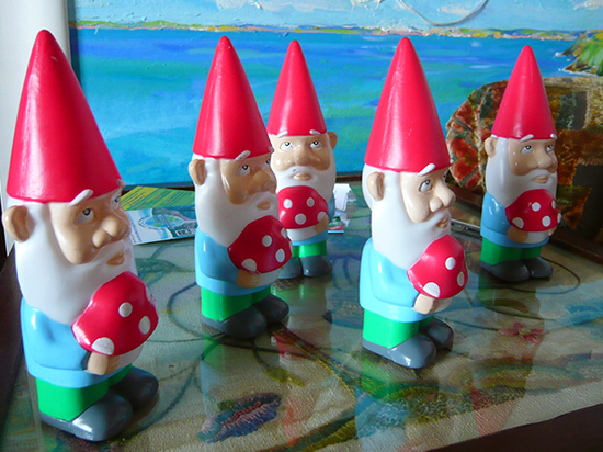 plastic knomes holding toadstools