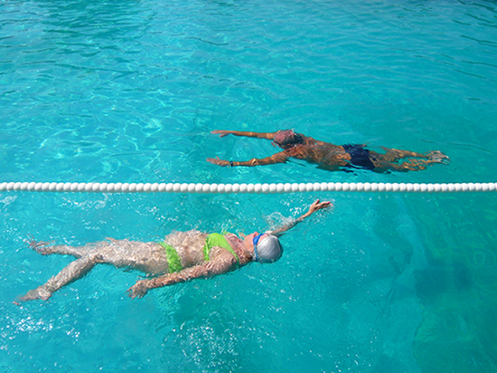 Two swimmers doing lengths