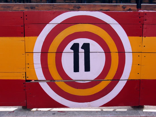 number eleven painted in in the middle of bright concentric circles