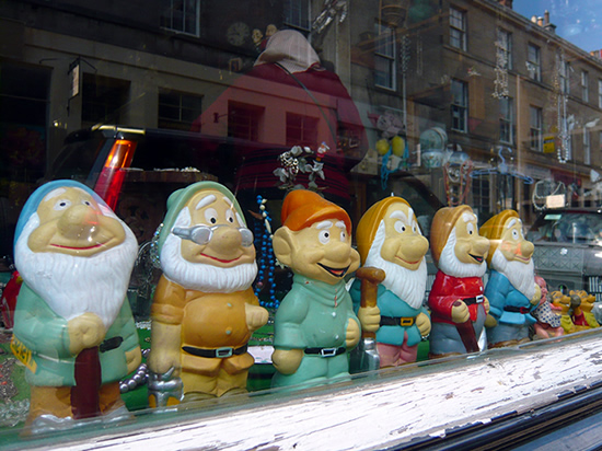 garden knomes of the seven dwarfs in shop window