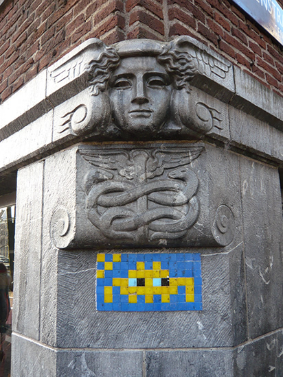small tiled mural of a space invader
