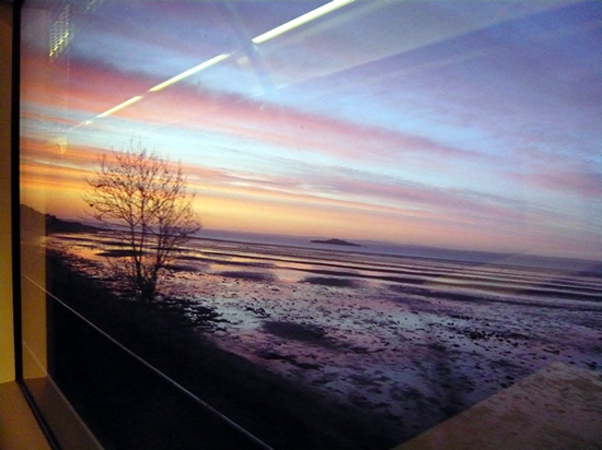 sunrise seen from a train window