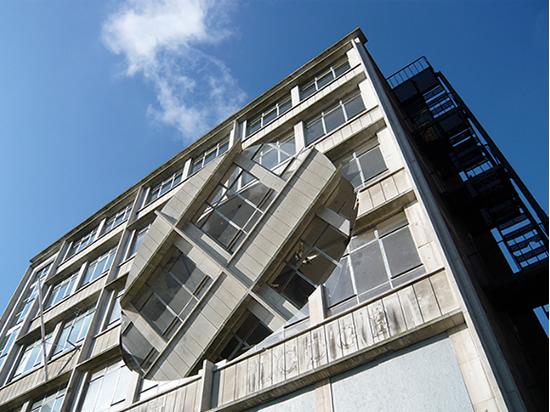 revolving oval cut into the facade of a building</