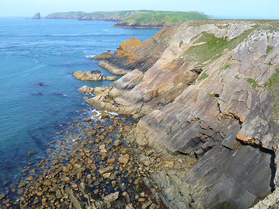 Pembrokeshire's rocky coast and cliffs and Skomer Island on the horizon