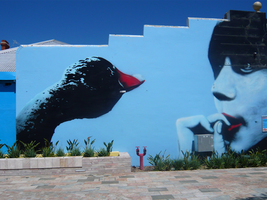 mural of black swan and woman's face