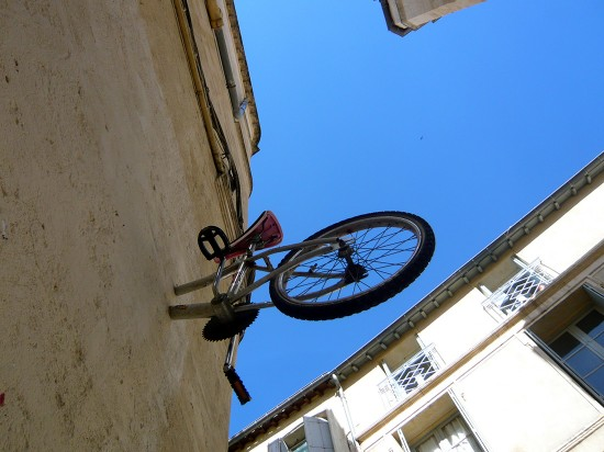 back half of a BMX bike sticking out of a wall
