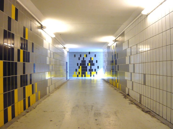 underground passage tiled and lit with flourescent lights