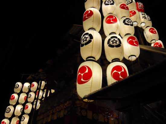 bright paper lanterns against a dark background - part of Gion Matsuri festival during 'yoiyama' evenings