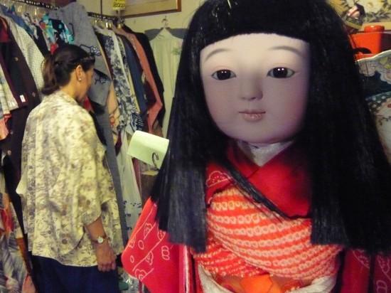 (市松人形) traditional jananese doll (Ichimatsu doll) in a second-hand kimono shop