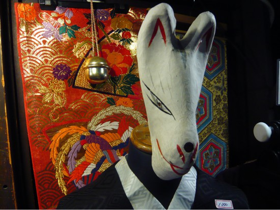 Japanese fox (Kitsune) mask on a manikin dressed outside a second-hand kimono shop